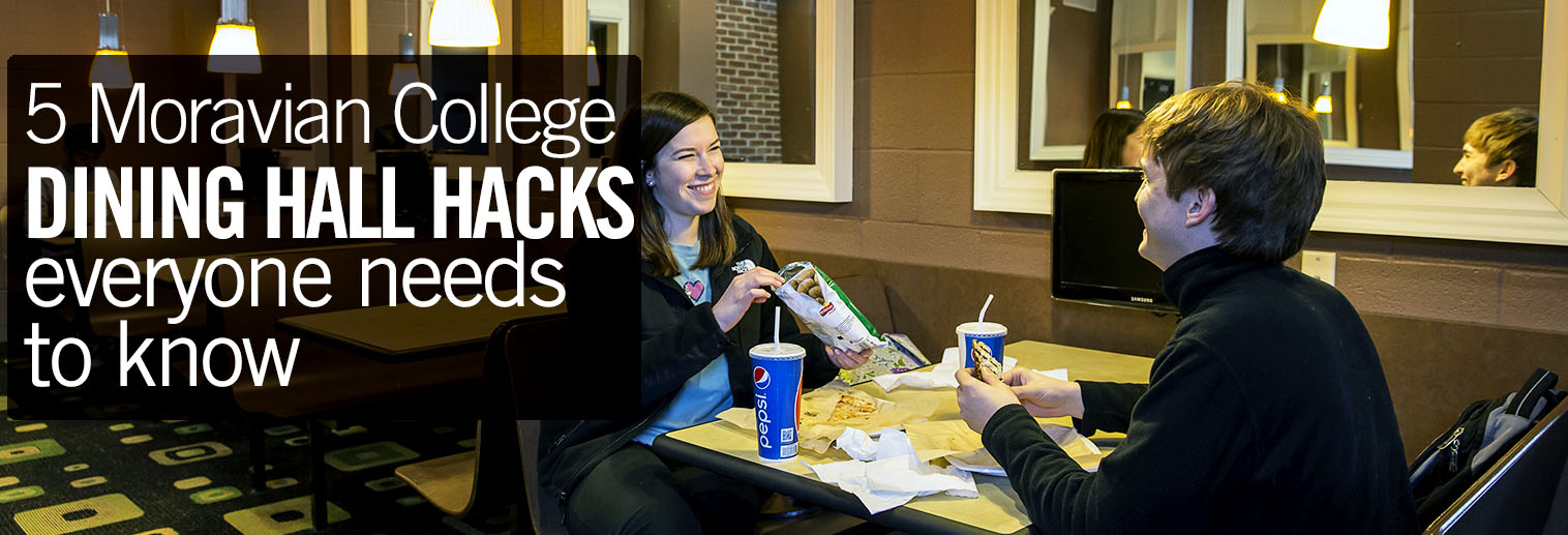 photo of two professors/administrators eating in booth in Root Cellar cafe