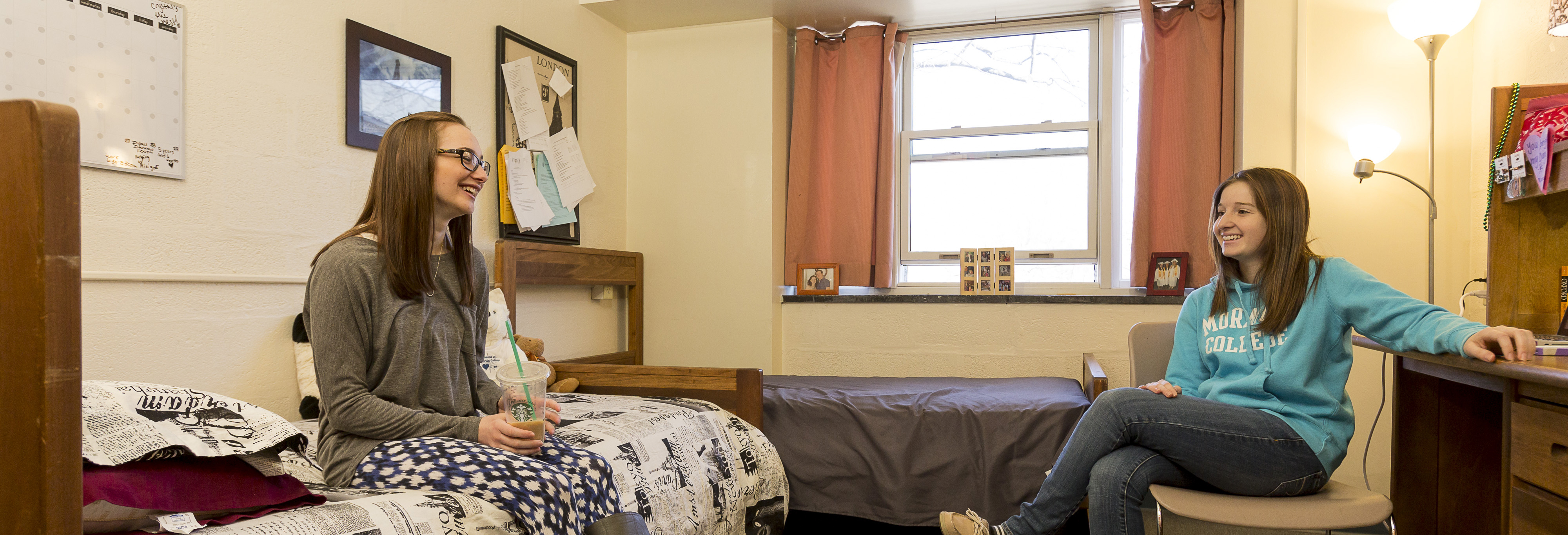 Photo of two students sitting in residence hall room