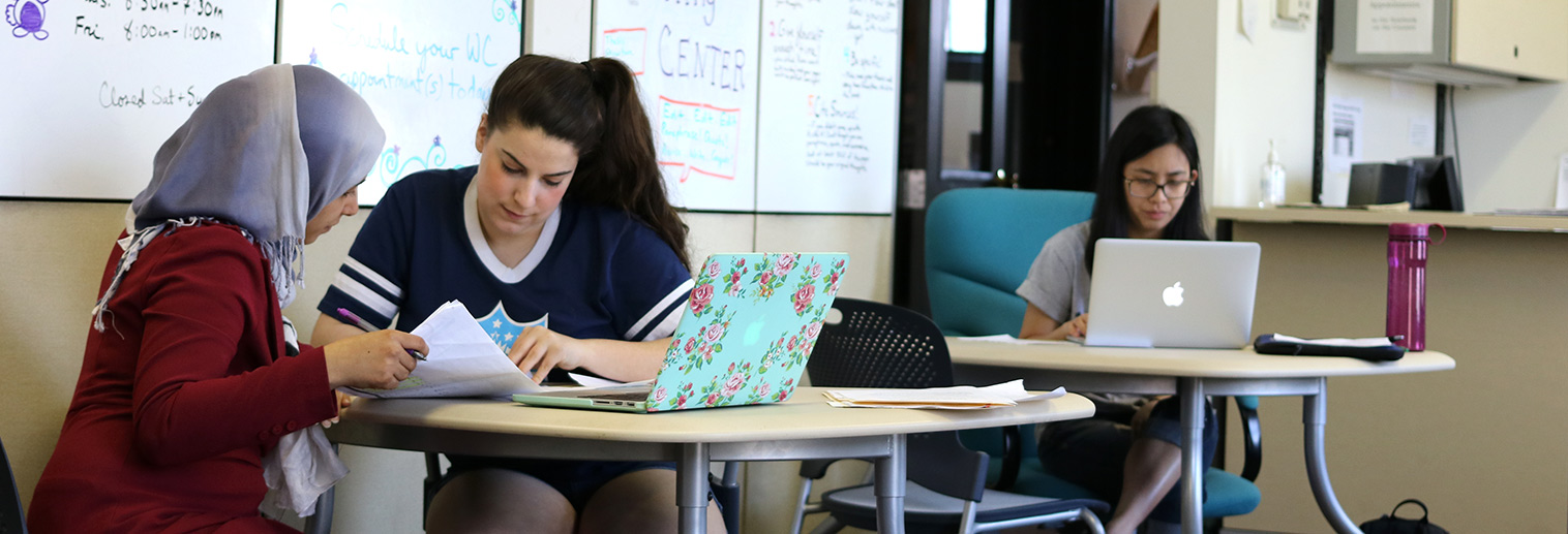 Writing Center tutor working with a student