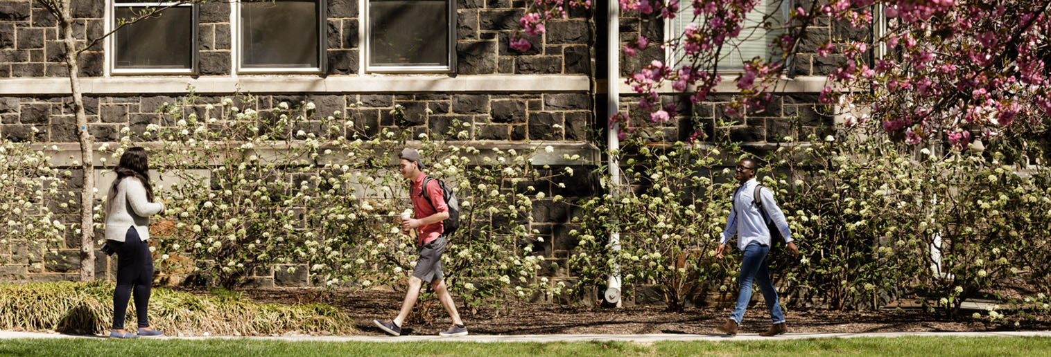 Moravian College students walking across historic campus in Bethlehem, PA