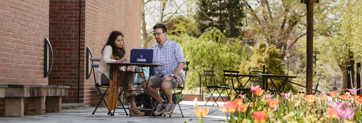 Student and Teacher work together on Moravian College campus in Bethlehem, PA