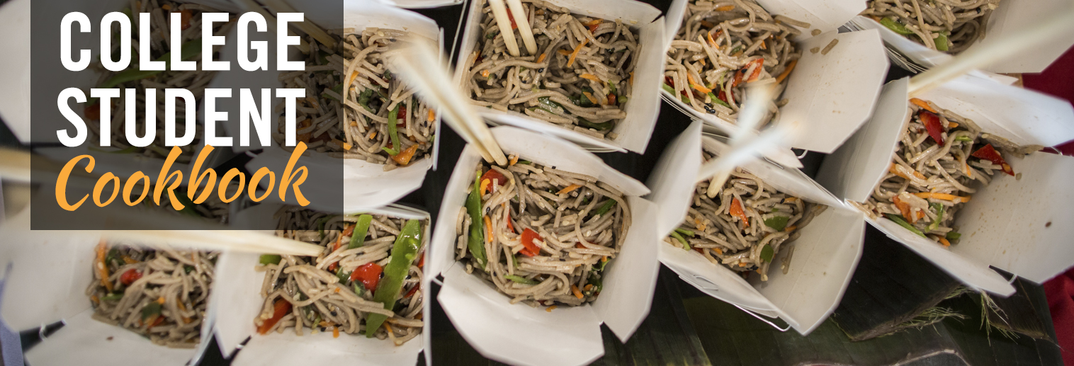 overview shot of Chinese takeout boxes with chopsticks, lo mein noodles, snow peas, red peppers, and carrots