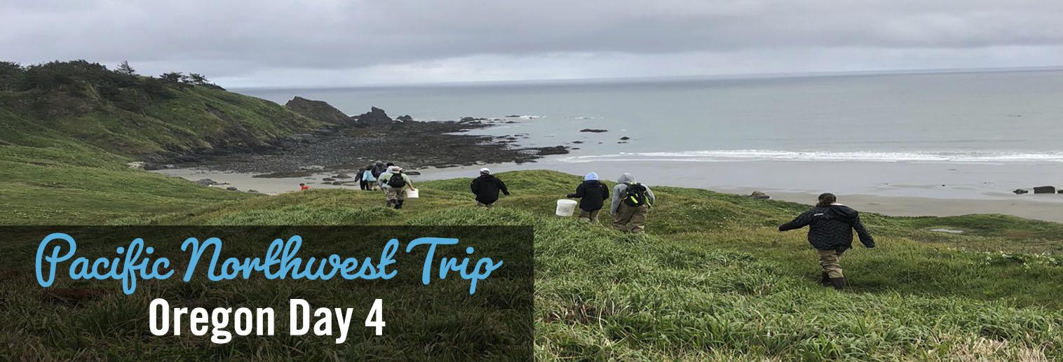 Moravian College students walking along grassy windswept clifftop on Oregon coast w/ocean in background
