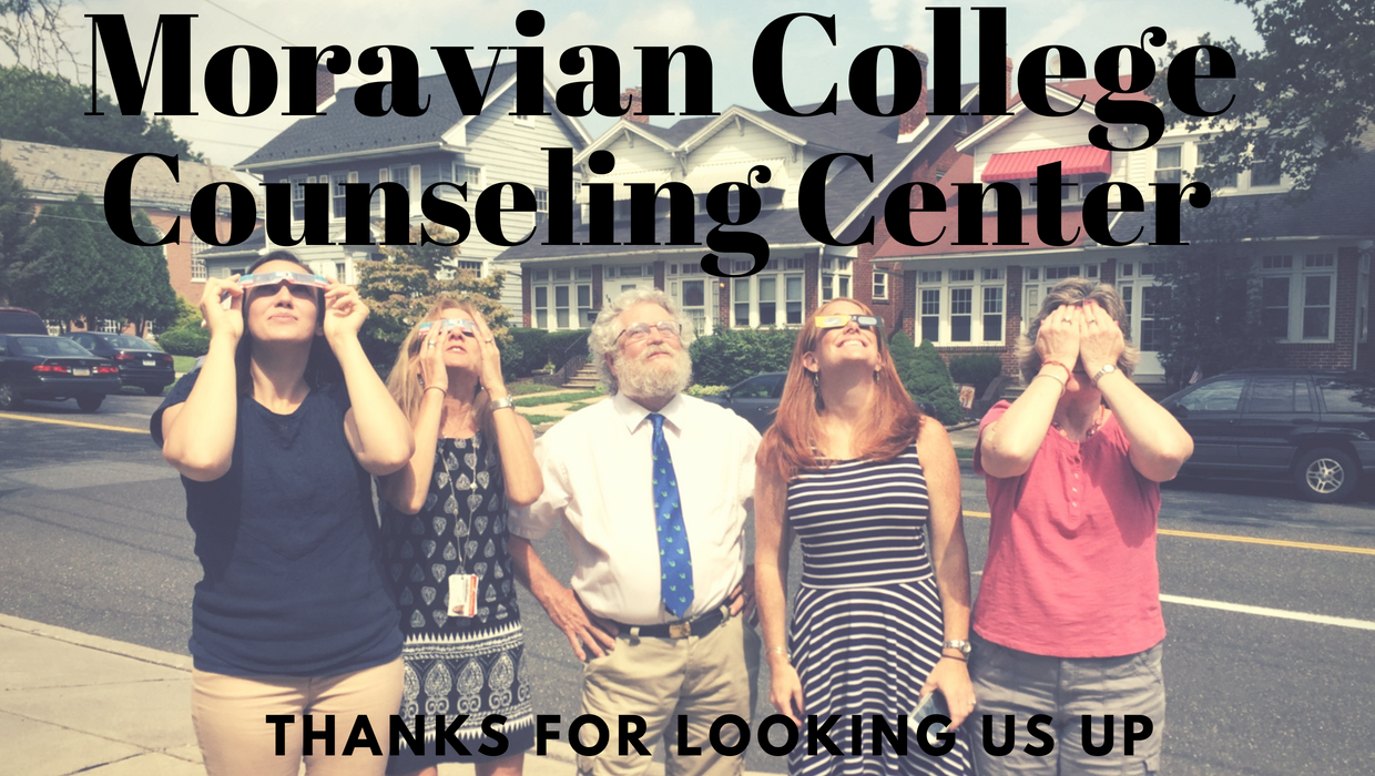 "The Counseling Center Staff ""looking"" at the eclipse of Fall 2017."