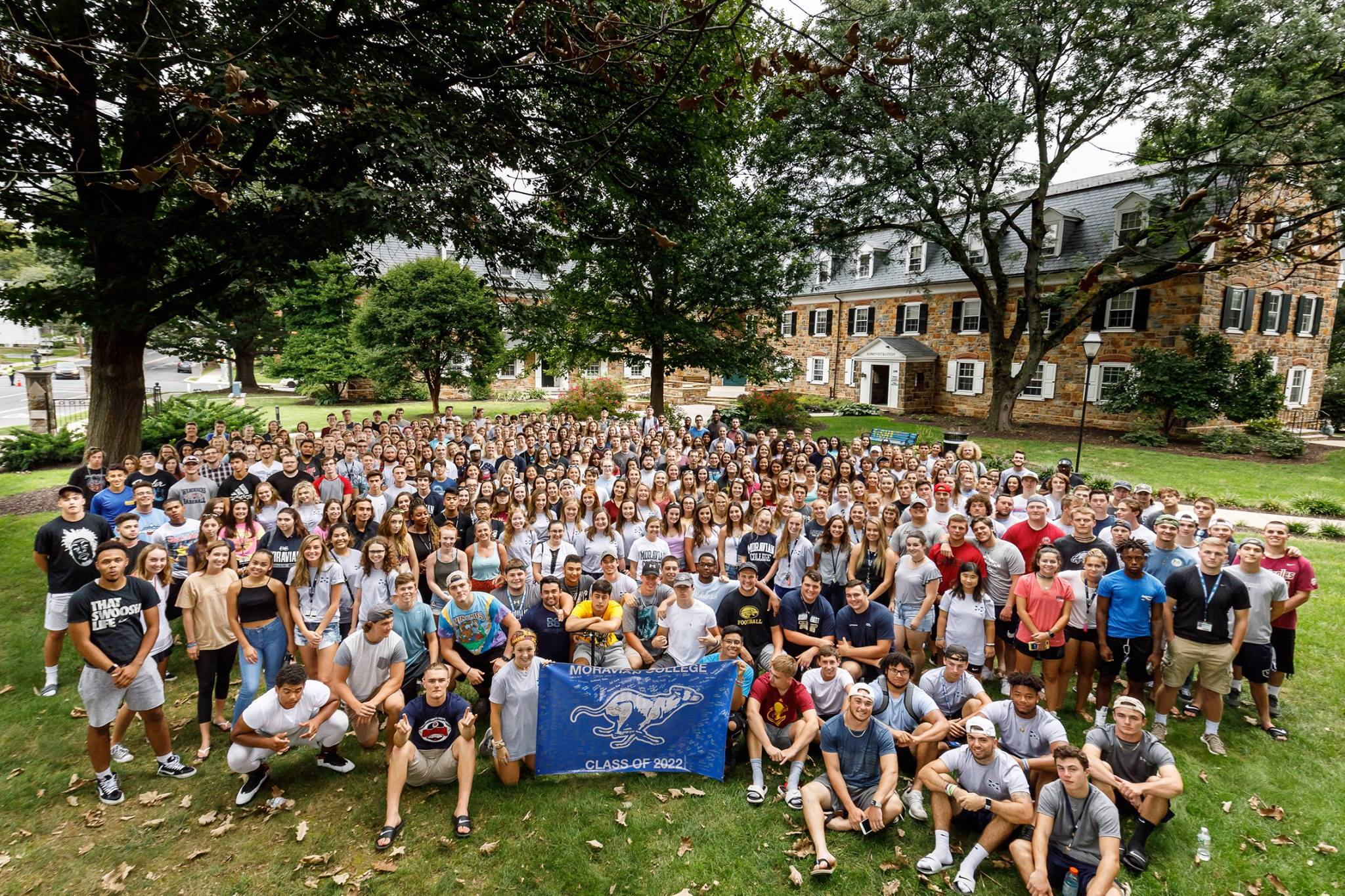 The freshmen class of 2022, which is about 450 students, is seated on the lawn looking up at the camera