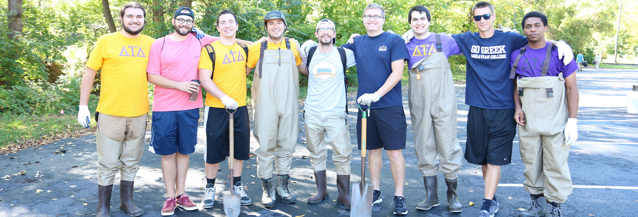 Delta Tau Delta members performing community service