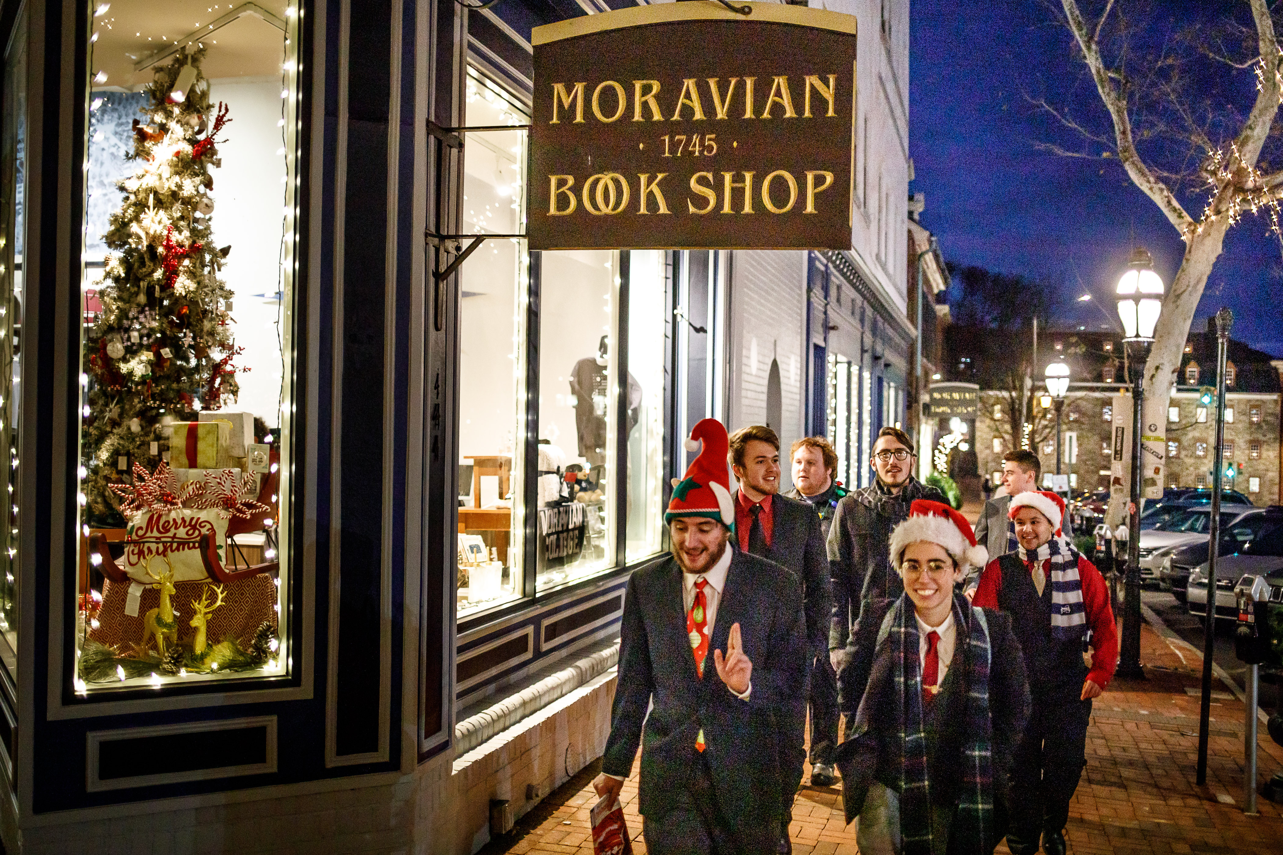 Students walk past the Moravian Book Shop