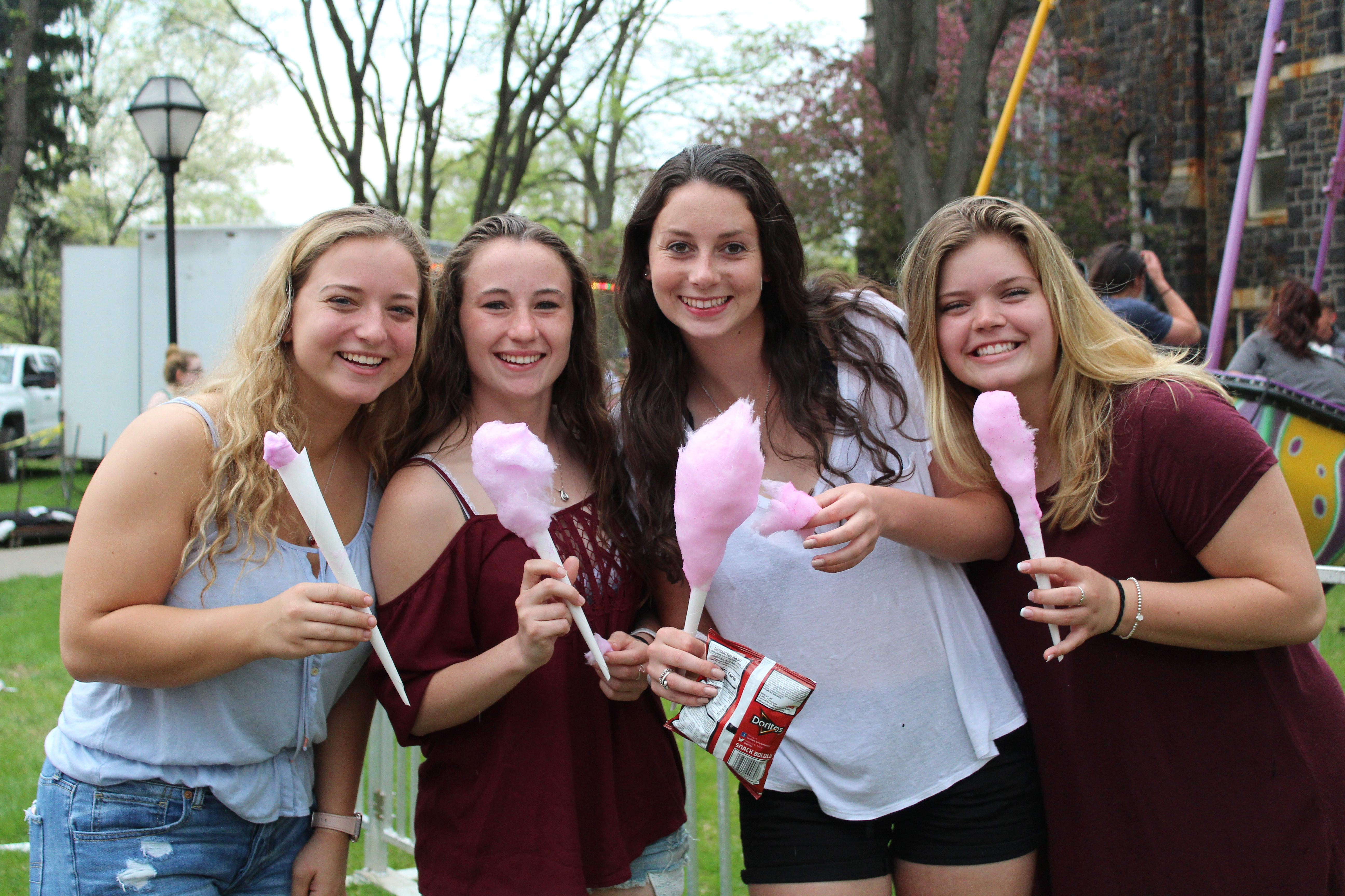 students enjoying cotton candy at spring fest
