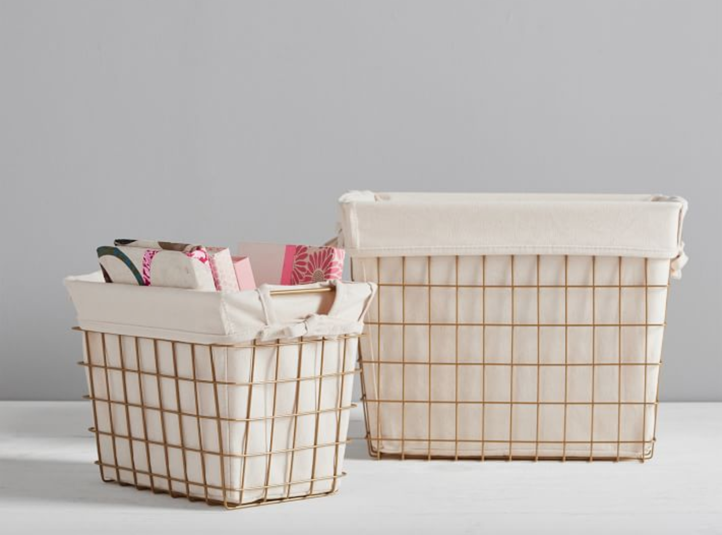 Pottery Barn lined wire storage baskets (gold colored wire, ivory colored linen lining)