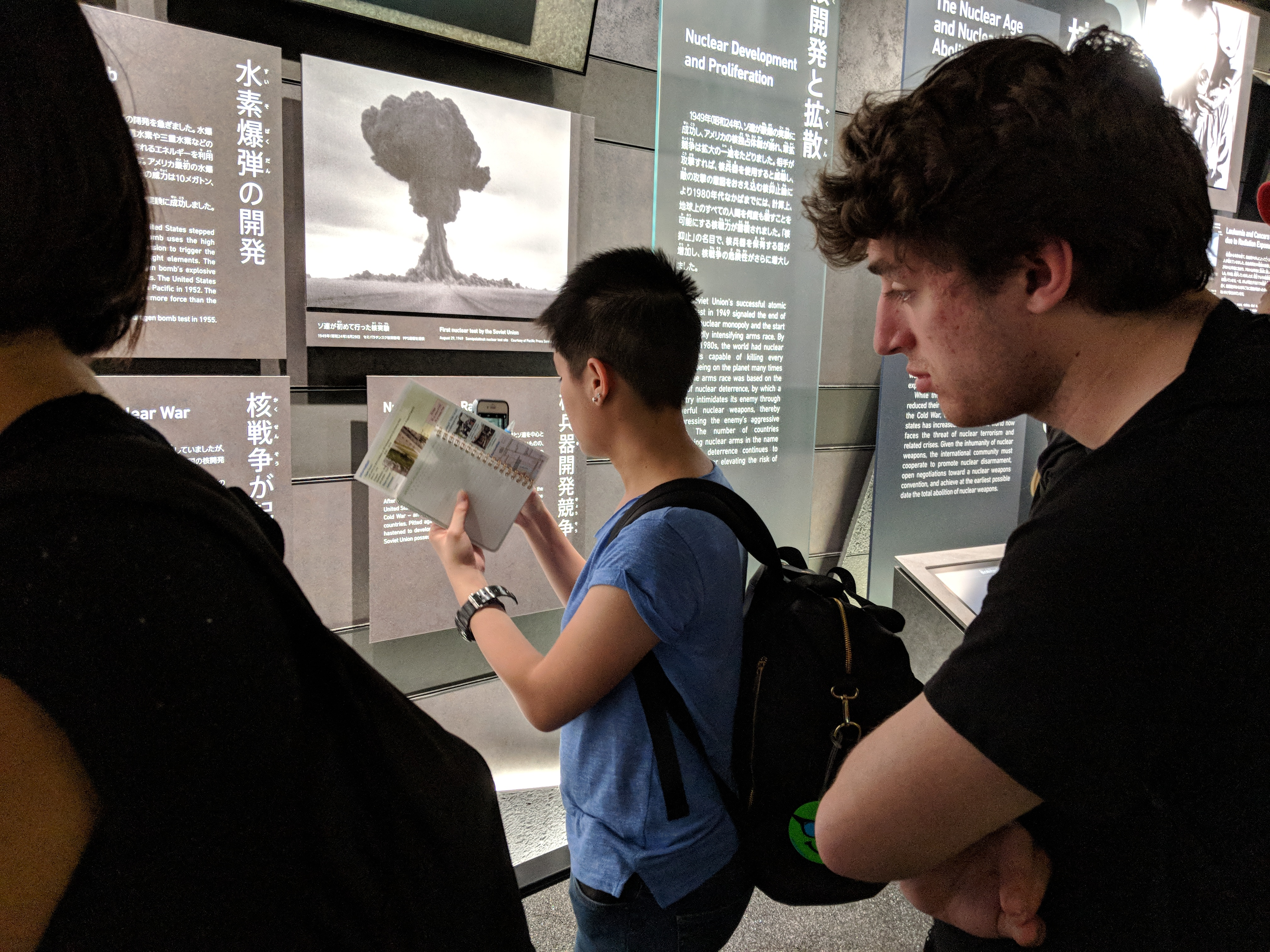 Students looking at an exhibit in the Hiroshima Peace Park Museum