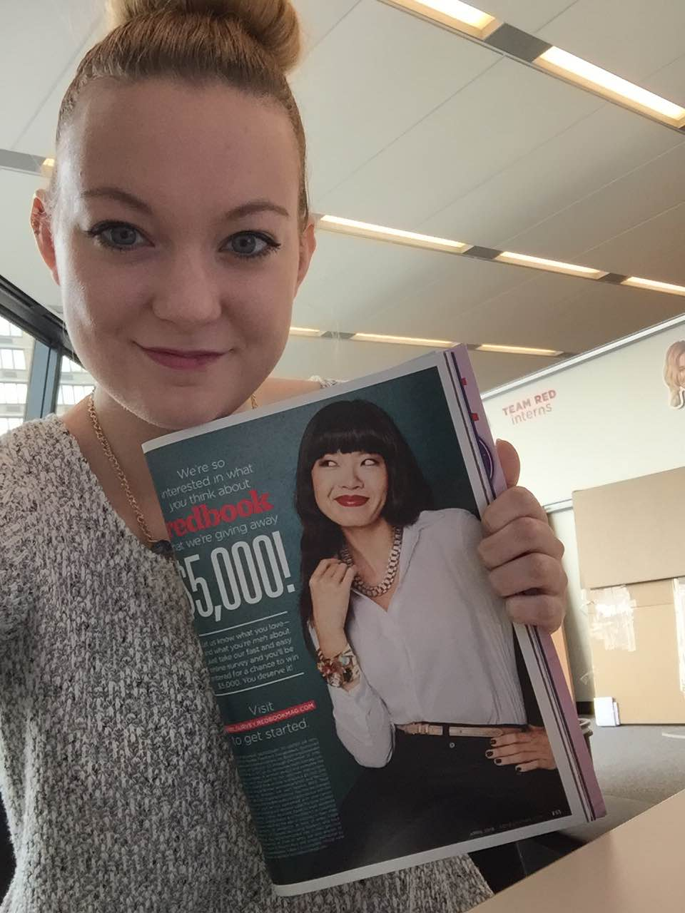 Caitlyn Heil with the spread she designed at her internship at Redbook Magazine