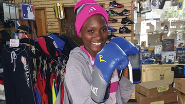 Jordania with her new boxing gloves. She is a fierce competitor!