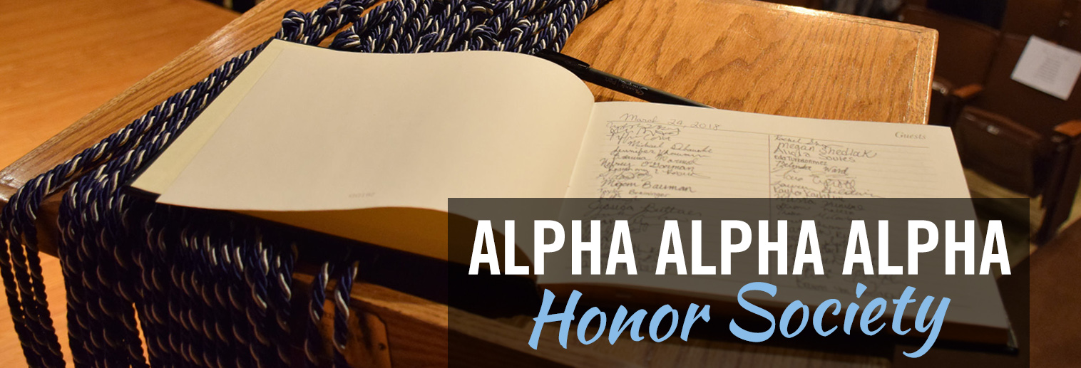 image of ledger with signatures of students inducted into Alpha Alpha Alpha with honor cords hanging from podium