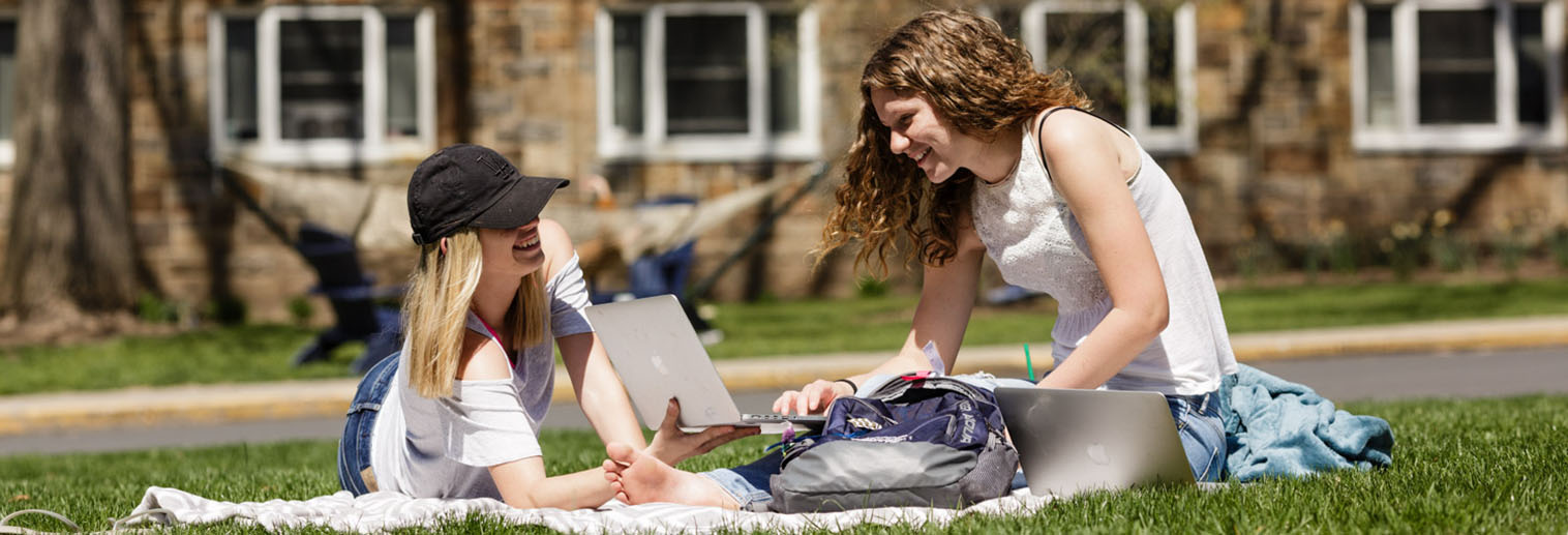 Students sit on the quad a Moravian College, offering undergraduate and graduate degrees in Bethlehem Lehigh Valley Pennsylvania