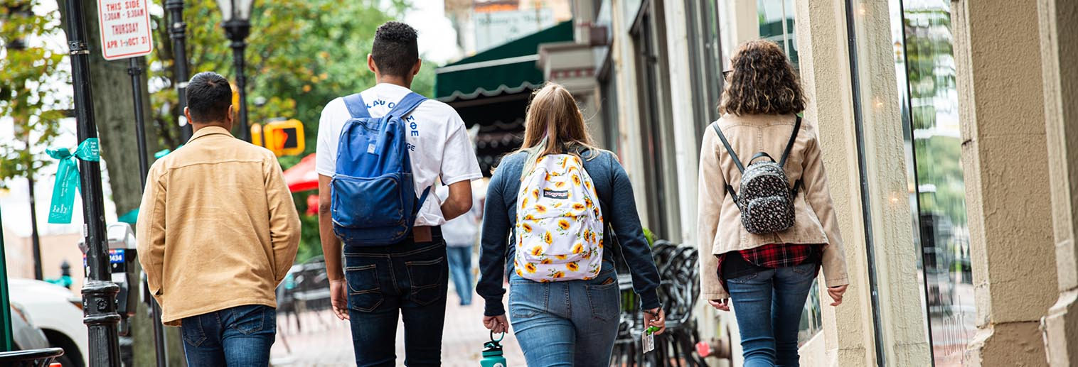 Four students walking in downtown Bethlehem