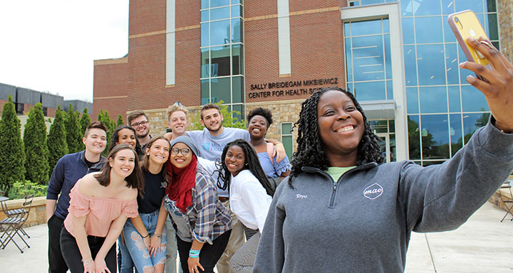 Students taking selfie in front of the Sally.