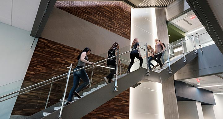 Students walking up staircase in the Sally