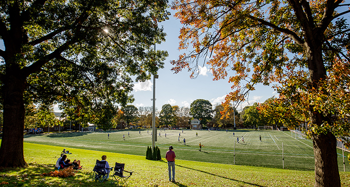 Spectators watching a game on campus